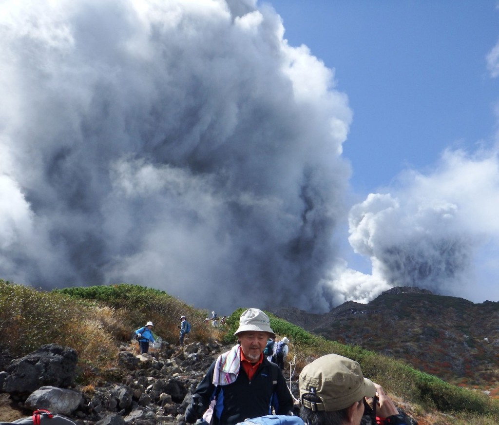 Climbers descend Mt. Ontake, which straddles Nagano and Gifu prefectures, to evacuate as the volcano erupts in central Japan