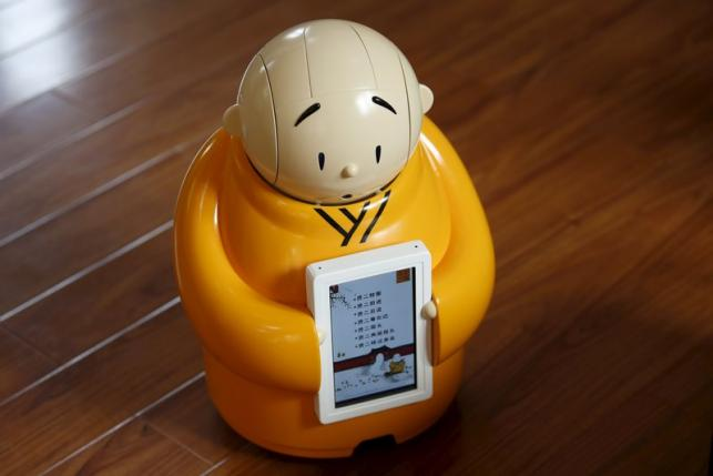 Robot monk Xian'er is pictured during its demonstration for a photo opportunity at Longquan Buddhist temple on the outskirts of Beijing